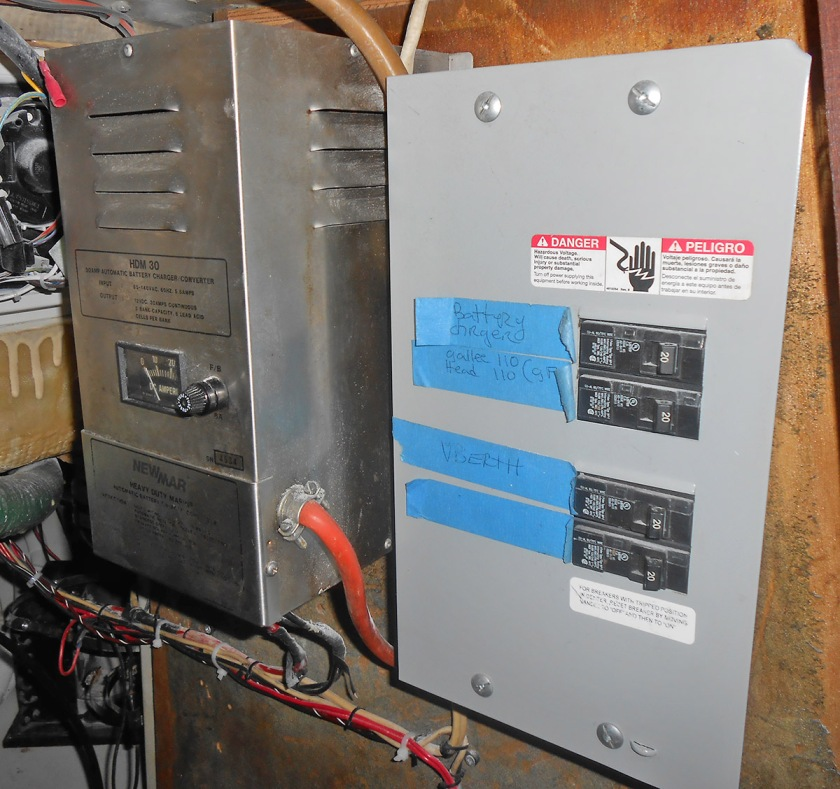 The old breaker panel and battery charger...scary stuff!